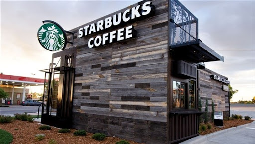 Starbucks coffee house made from containers; truck and container loading software