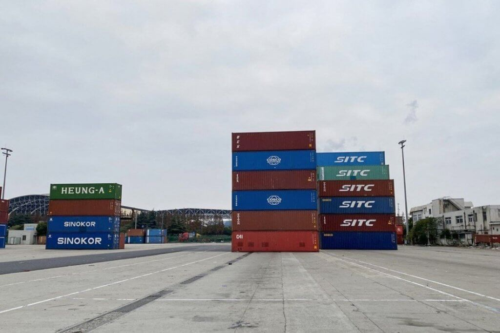 Empty freight containers stacked up at Shanghai's Waigaoqiao port - Container Shortage 2021